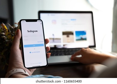 CHIANG MAI, THAILAND - AUG 18, 2018: A woman holds Apple iPhone X with Instagram application on the screen. Instagram is a photo-sharing app for smartphones.