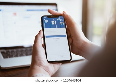 CHIANG MAI ,THAILAND AUG 18 2018 : Woman holding a iPhone X with social Internet service Facebook on the screen.