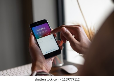 CHIANG MAI, THAILAND - AUG 20, 2018: A woman hand holding iphone with login screen of instagram application. Instagram is largest and most popular photograph social networking.
