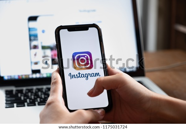 CHIANG MAI, THAILAND - AUG 26, 2018: A woman holds Apple iPhone X with Instagram application on the screen at cafe. Instagram is a photo-sharing app for smartphones.