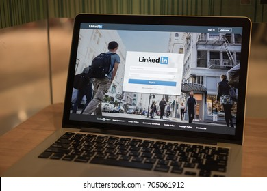 CHIANG MAI ,THAILAND AUG 29, 2017 : Apple Macbook pro with page social network service LinkedIn on the screen.