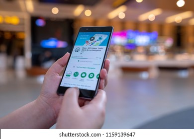 CHIANG MAI, THAILAND - August 03,2018: Woman hands holding HUAWEI with Waze app on the screen. Waze is the world's largest community based traffic and navigation app.