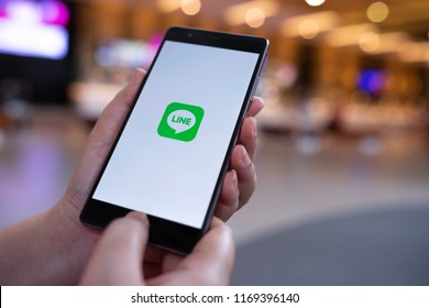 CHIANG MAI, THAILAND - August 03,2018: Woman hands holding HUAWEI with LINE apps on screen. LINE is a new communication app which allows you to make free voice calls and send free messages.
