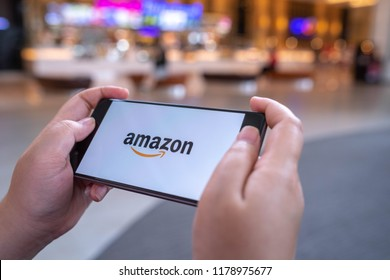 CHIANG MAI, THAILAND - August 03,2018: Woman hands holding HUAWEI with Amazon apps. Amazon is an American international electronic commerce company. It's the world's largest online retailer.