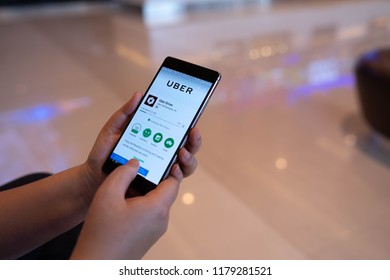 CHIANG MAI, THAILAND - August 03,2018: Woan hands holding HUAWEI with Uber apps. Uber is smartphone app transportation network for searching, calling and paying a taxi or private drivers.