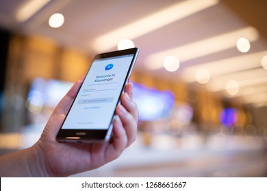 CHIANG MAI, THAILAND - August 03,2018: Woman holding HUAWEI with facebook messenger app on screen.Facebook Messenger is a mobile tool that allows users to send chat messages to friends on Facebook.