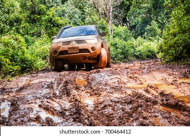 CHIANG MAI, THAILAND - AUGUST 14, 2017 : Undefined Driver on Mitsubishi Triton off-road car on muddy road in the countryside, Chiang mai, Thailand.