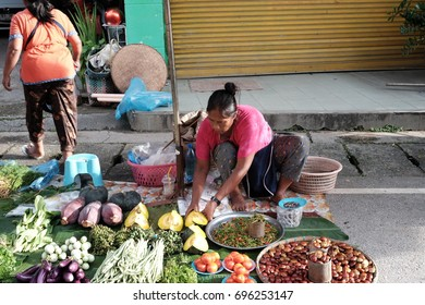 CHIANG MAI THAILAND- AUGUST 14:Unidentified woman sells vegetables on the street on August 14,2017 at Chiang Mai Thailand.