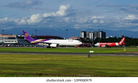 Chiang Mai, Thailand - August 15, 2018: Airbus A330-300 of Thai Airways on taxiway of Chiang Mai Airport