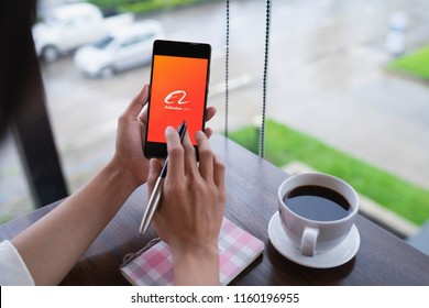 CHIANG MAI, THAILAND - August 18,2018: Woman hands holding HUAWEI with alibaba apps on screen.Alibaba's the the world's biggest online commerce company. It's three main sites Taobao,Tmall and Alibaba.