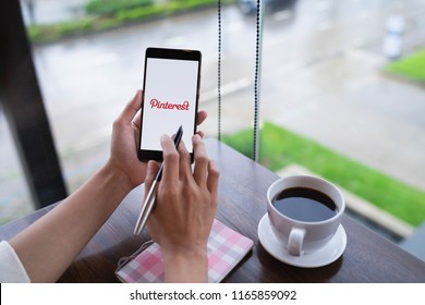 CHIANG MAI, THAILAND - August 18,2018: Woman hands holding HUAWEI mobile phone with Pinterest apps on screen. Pinterest is an online pinboard that allows people to pin their interesting things.