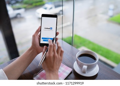 CHIANG MAI, THAILAND - August 18,2018: Woman hands holding HUAWEI mobile phone with Linkedin application on the screen. Linkedin is a business and employment oriented social networking service.