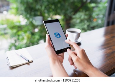 CHIANG MAI, THAILAND - August 18,2018: Woman holding HUAWEI with skype apps. Skype is part of Microsoft, can make video, audio calls, chat messages and do much more using Skype.