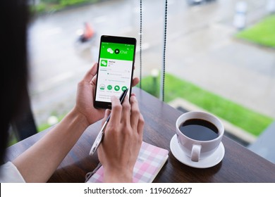 CHIANG MAI, THAILAND - August 18,2018: Woman holding HUAWEI with WeChat  on the screen.WeChat is a Chinese multi-purpose messaging, social media and mobile payment app developed by Tencent.