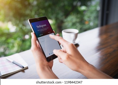 CHIANG MAI, THAILAND - August 18,2018: Woman holding HUAWEI with Instagram application on the screen. Instagram is a popular online social networking service.