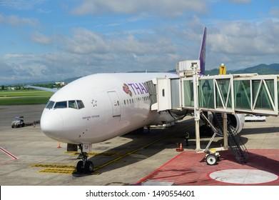 Chiang Mai, Thailand - August 19, 2019 : Thai Airways Boeing 777-200ER waiting for passenger boarding at Chiang Mai airport