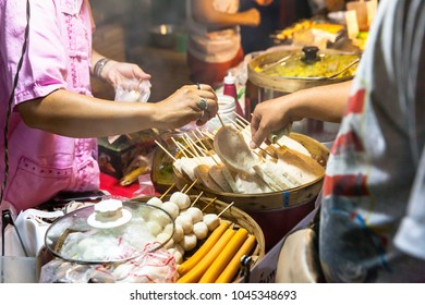 CHIANG MAI, THAILAND - AUGUST 21: Man buys street food at the Sunday Market (Walking Street) on August 21, 2016 in Chiang Mai, Thailand.