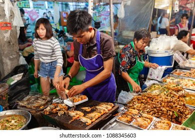 CHIANG MAI, THAILAND - AUGUST 27: Man prepare prawns for sale at the  Saturday night market in Chiang Mai (Walking Street) on August 27, 2016 in Chiang Mai, Thailand.