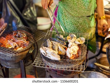 CHIANG MAI, THAILAND - AUGUST 27: Food vendor cooks seafood at the Saturday Night Market (Walking Street) on August 27, 2016 in Chiang Mai, Thailand.