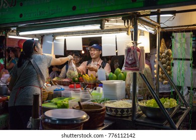 CHIANG MAI, THAILAND - AUGUST 27: Woman sells traditional Thai food at the Saturday Night Market (Walking Street)  on August 27, 2016 in Chiang Mai, Thailand.