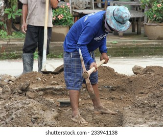 CHIANG MAI, THAILAND - AUGUST 31: Local workmen digging ditches for new drainage in Pai, north of Chiang Mai, Thailand on the 31st August, 2014.