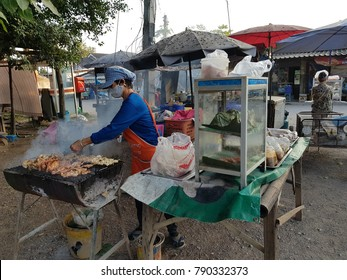 Chiang Mai, Thailand -  Circa December 2017: Grilled pork is one of many favorite street foods in the north of Thailand especially Chiang Mai. Outdoor grilled food stalls are usually found around.