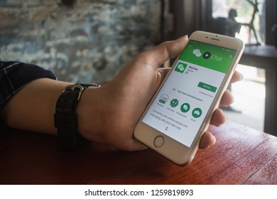 CHIANG MAI, THAILAND - DEC 16 2018 : Man holding a iPhone 6s and open appstore searching social Internet service WhatsApp on the screen. iPhone 6s was created and developed by the Apple inc.