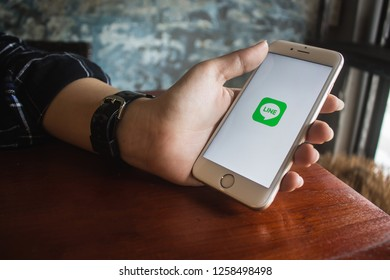 CHIANG MAI, THAILAND - DEC 16,2018: Woman holding iphone 6s with LINE apps on screen. LINE is a new communication app which allows you to make free voice calls and send free messages.
