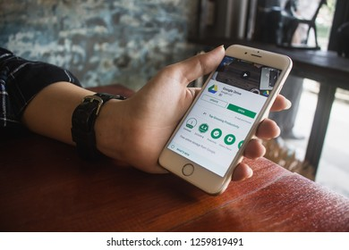 CHIANG MAI, THAILAND - DEC 16,2018: Man holding iPhone 6s with Google Drive apps on screen. Google Drive is a free service from Google that allows you to store files online.