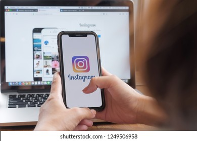 CHIANG MAI, THAILAND - DEC 2, 2018: A woman holds Apple iPhone X with Instagram application on the screen at cafe. Instagram is a photo-sharing app for smartphones.