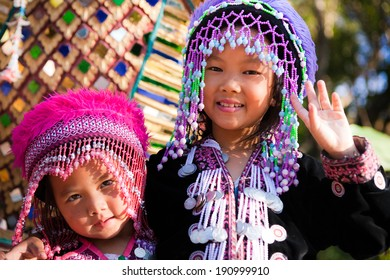 CHIANG MAI, THAILAND - DEC 24: Two unidentified Akha children pose for tourist photos at Wat Phratat Doi Suthep on December 24, 2010 in Chiang Mai, Thailand.