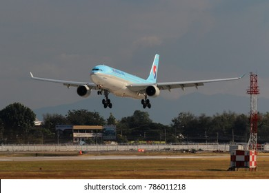 Chiang Mai, Thailand. Dec 31, 2017.Korean Air Airbus A330 Flight KE667 From Seoul Landing at Chiang Mai International Airport. Change Outbound Flight Schedule for Safety from Floating Lanterns Balloon