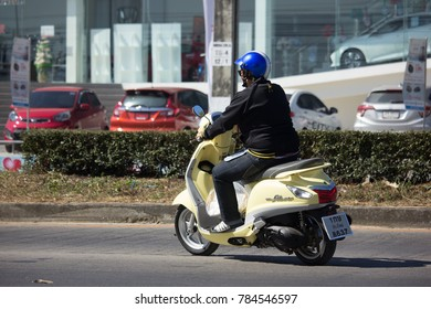 CHIANG MAI, THAILAND -DECEMBER 15 2017: Man with  Automatic Scooter Yamaha Filano Motorcycle. On road no.1001, 8 km from Chiangmai Business Area.