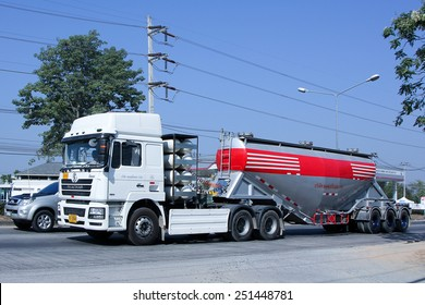 CHIANG MAI, THAILAND - DECEMBER  25 2014:   Cement truck of Phadungrit Transport.  Photo at road no.1001 about 8 km from city center, thailand.