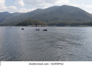Chiang Mai, Thailand - December 27, 2016:  Tourists kayaking on lake in the mountains at Mae Ngad Dam and Reservoir in Chiang Mai, Thailand on December 27, 2016
