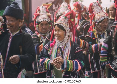 CHIANG MAI, THAILAND - DECEMBER 31, 2013: Unidentified Akha indigenous hill tribe woman in traditional clothes. Asian ethnic tribal group. Popular tourist travel destination in north Thailand