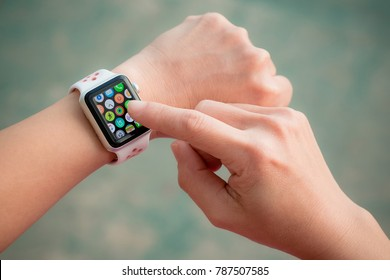 Chiang Mai, Thailand - December 7, 2017: Woman wearing Apple watch. Multiple Apps View.