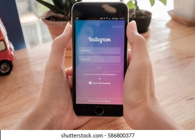 CHIANG MAI, THAILAND - Feb 13, 2017: A woman holds Apple iPhone 6S with Instagram application on the screen. Instagram is a photo-sharing app for smartphones.