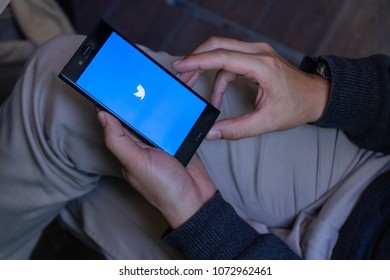 CHIANG MAI, THAILAND - Feb 13,2018: Man hand holding Sony xperia xzs with Twitter app on the screen.Twitter is an online news and social networking service where users post and interact with messages.