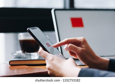 CHIANG MAI, THAILAND - FEB. 18,2019: Woman holding HUAWEI with Youtube apps on screen. YouTube is the popular online video sharing website.