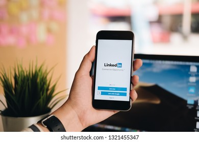 Chiang Mai, Thailand. FEB 19, 2019. A women holds Apple iPhone 6S with LinkedIn application on the screen.LinkedIn is a photo-sharing app for smartphones.