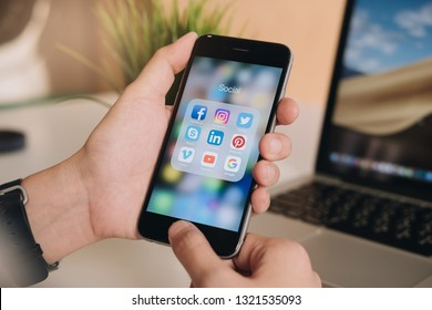 CHIANG MAI, THAILAND - Feb 19 ,2019: Woman holding Apple iPhone 6S  with icons of social media on screen. Social media are most popular tool. Smartphone life style. Starting social media app.