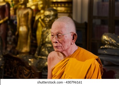 CHIANG MAI, THAILAND - FEB 21: Realistic statue of an old monk who meditates and attained nirvana on February 21, 2016. King Mengrai founded the city of Chiang Mai in 1296