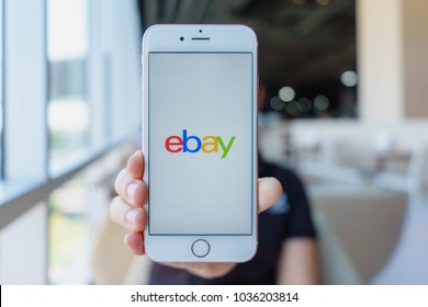 CHIANG MAI, THAILAND - Feb 22,2018: Woman holding Apple iPhone 6S Rose Gold with eBay apps on the screen. eBay is one of the most popular ways to buy and sell goods and services on the internet.
