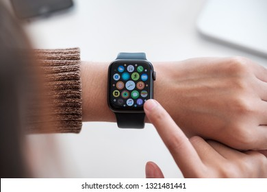 CHIANG MAI ,THAILAND FEB 24, 2019 : Woman hand with Apple Watch Series 4 over the table. Apple Watch was created and developed by the Apple inc.