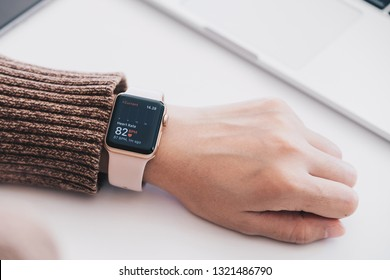 CHIANG MAI ,THAILAND FEB 24, 2019 : Woman hand with Apple Watch Series 3 with Heart Rate on the screen. Apple Watch was created and developed by the Apple inc.