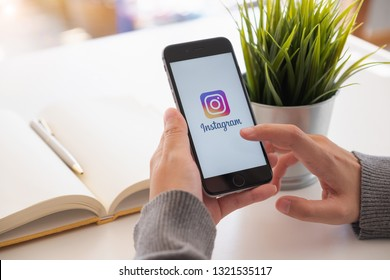 CHIANG MAI, THAILAND - FEB 24, 2019: A woman holds Apple iPhone 6s with Instagram application on the screen at home. Instagram is a photo-sharing app for smartphones.