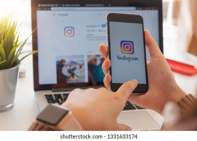 CHIANG MAI, THAILAND - FEB 24  2019: A woman holds Apple iPhone 6s with Instagram application on the screen at cafe. Instagram is a photo-sharing app for smartphones