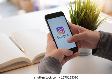 CHIANG MAI, THAILAND - FEB 24, 2019: A woman holds Apple iPhone 6s with Instagram application on the screen at cafe. Instagram is a photo-sharing app for smartphones