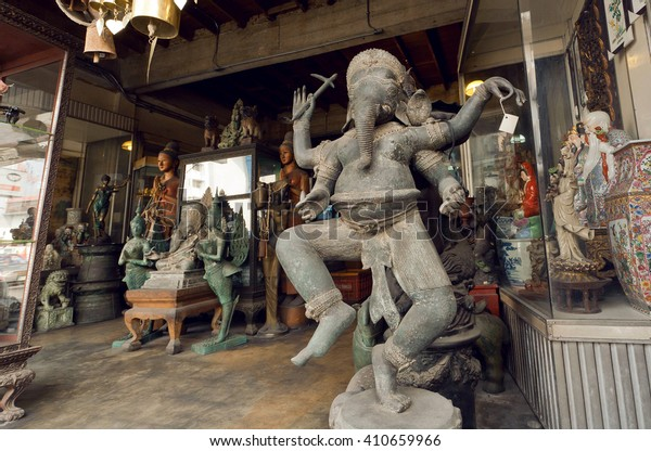 CHIANG MAI, THAILAND - FEB 25: Vintage statue of Lord Ganesha and many retro style souvenirs in antique shop on thai street on February 25, 2016. King Mengrai founded the city of Chiang Mai in 1296